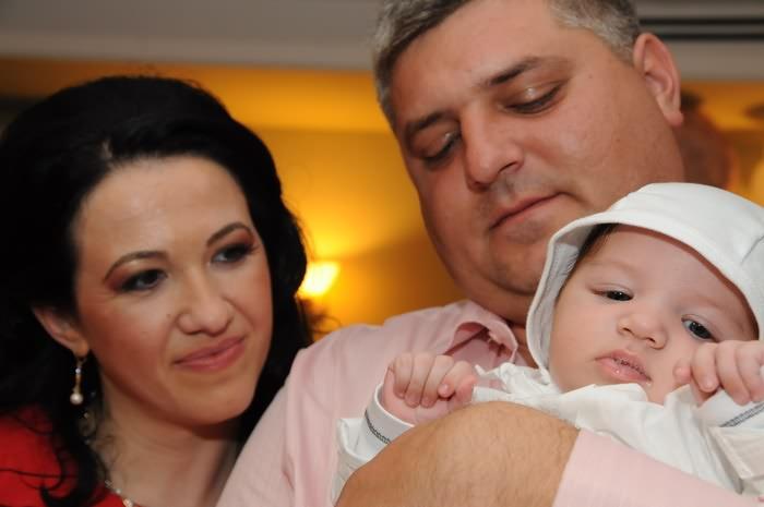 fotografii cu copilul si parintii la botez