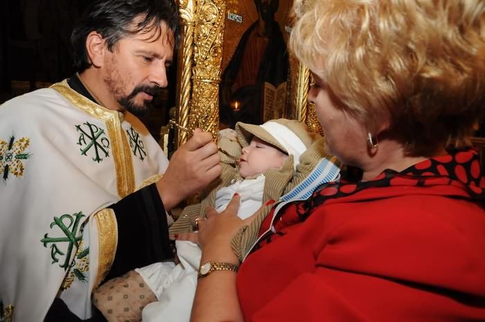 poze la impartasire dupa botez